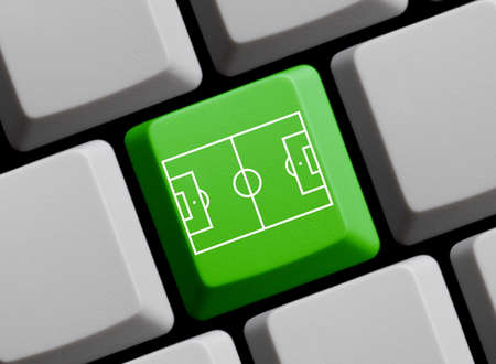 Green computer keyboard showing football pitch or soccer stadium