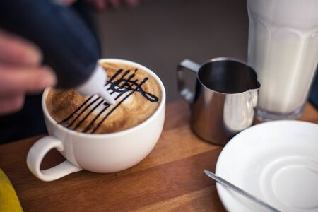 cup of coffee with a picture of latte art Standard-Bild
