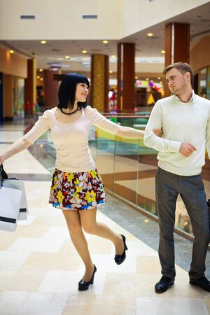 young couple shopping for sale Stock Photo