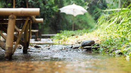White umbrella in brook Stock Photo