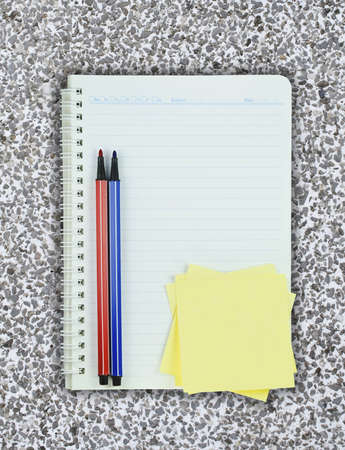 Book, colorful pen and post it on Terrazzo background  photo