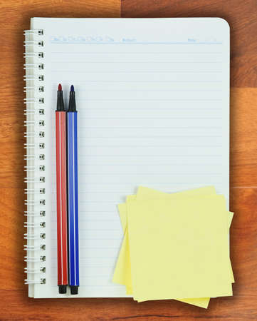 Book, Colorful pen and Post it on Parquet background  photo
