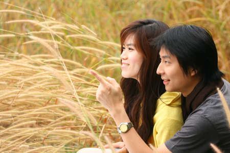 An asian couple point the finger Stock Photo - 11301335