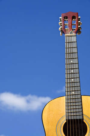 Guitar on blue sky photo
