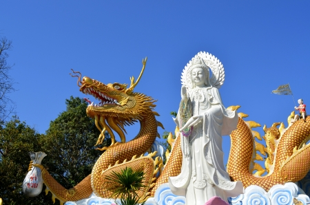 Guan Yin and dragon photo