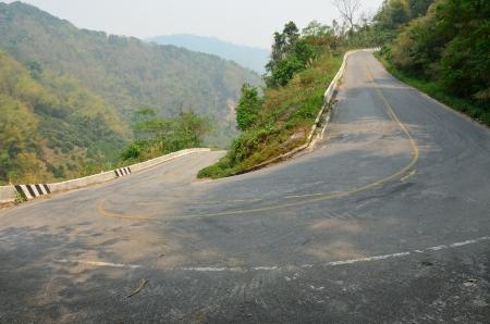 Curved road at Doi Ang Khang,Thailand photo