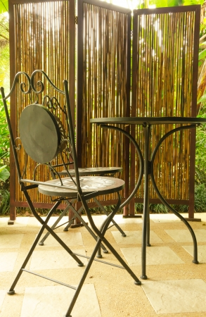 Bamboo curtain and Steel modern chair and table in coffee shop photo
