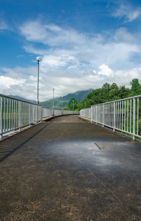pathway on top of dam for overlooking the water and mountains Stock Photo - 22964376
