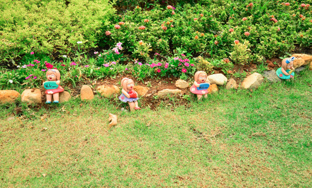 Cute Clay doll in the garden photo