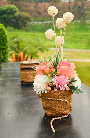 beautiful bouquet on table in outdoor garden photo