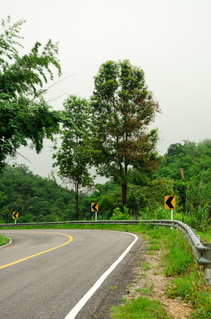 driving conditions: Curve road and rainforest in Thailand mountain Stock Photo
