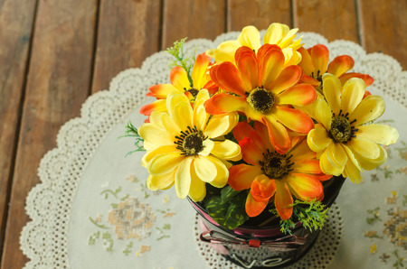 beautiful flower in pot decoration on table at coffee shop photo