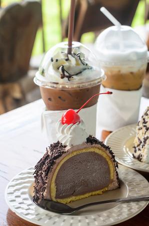 Ice cream cake chocolate and red cherry photo