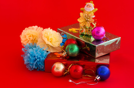 scarf beach: decoration of christmas and gift box on red