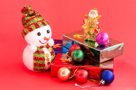 decoration of christmas and gift box on sweet pink color tone background photo