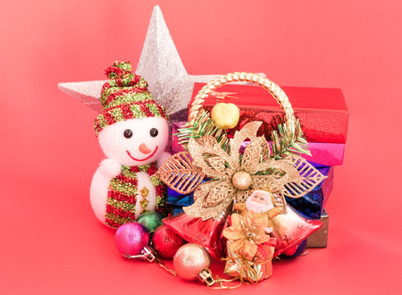 scarf beach: decoration of christmas and gift box on sweet pink color tone background Stock Photo