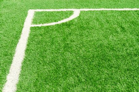 white corner field line on artificial green grass of soccer field photo