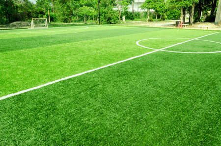 white stripe on artificial green grass of soccer field Stock Photo