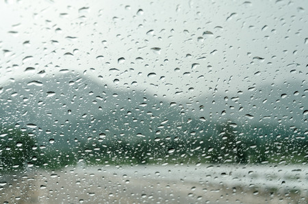 auto glass: raindrops on auto glass with mountain view