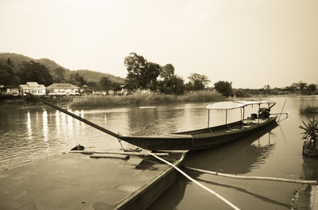 asian ancestry: CHIANG MAI THAILAND  MAY 15: blur retro and grain image of longtailed boat at Baan Tha Ton in Mae Ai Chiang Maitransportation by boat that will not be popular in current.
