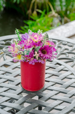 out door: beautiful flower in canned D.I.Y (Do it yourself) the decoration on table at out door coffee cafe