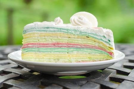Crepe cake rainbow and white chocolate photo