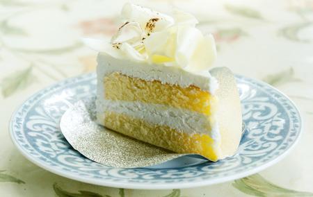 fruit eater: Vanilla cake and white chocolate topping Stock Photo