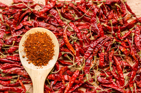 crushed red peppers: red dried chili pepper and wooden spoon