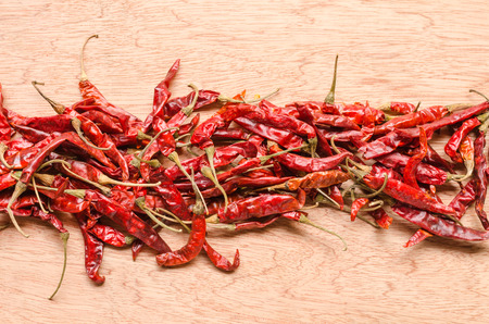 red dried chili pepper on wood background