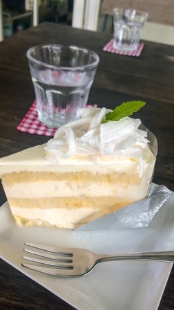 layer cake: coconut layer cake on white dish