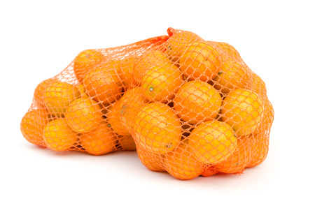 cumquat: Gumquat in mesh bag on white isolated