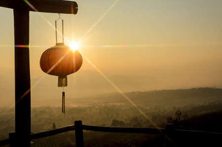 mountain view: Chinese lanterns with rays of sunrise and mountain view