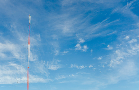 blue sky with clouds and communication towers Stock Photo
