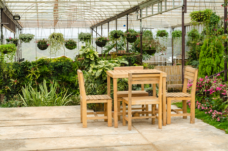 garden furniture: wooden furniture table and chair in relaxing garden