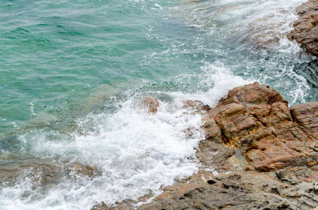 sea waves and rock coast, seascape in Thailand