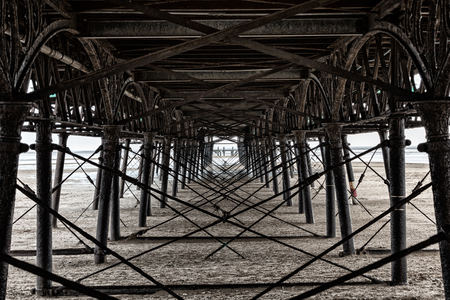 a view from under the pier at low tide, lancashire, england