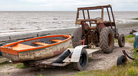 an old tractor and boat on the beach at Lytham, Lancashire, UK