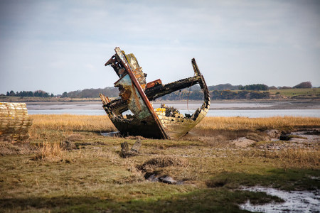 An old wreck lies on the marsh on the wyre estuary