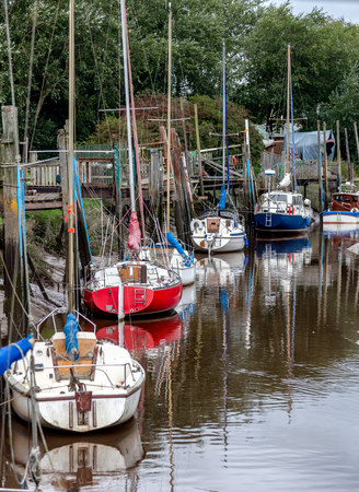 A   line of boats moored in skippool creek