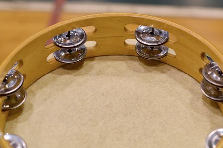 pandero: Closeup tambourine on drum in gym