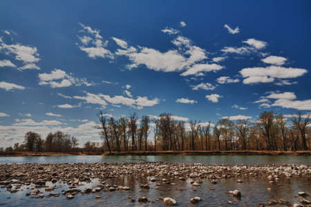 The Bow River under a blue sky with clouds  Stock Photo