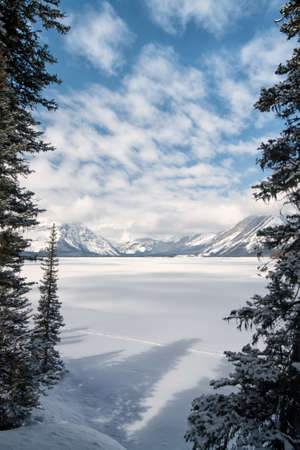 Upper Kananaksi Lake framed by trees in the winter. Stock Photo - 15157122