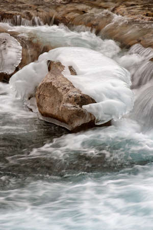Ice covered rock at Elbow Falls Alberta  Stock Photo - 15524773