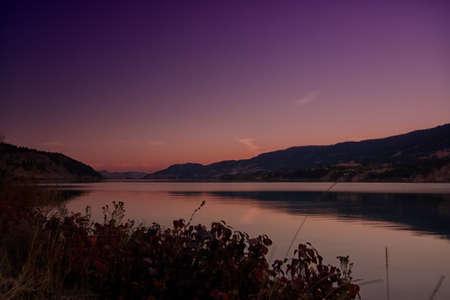 Pink sunset on Wood Lake British Columbia.   Stock Photo