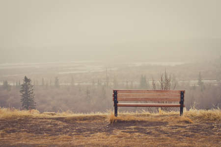 Bench looking over a misty landscape