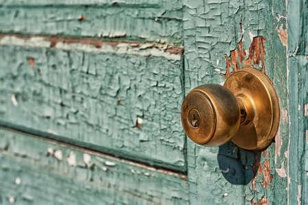 Peeling paint on an old turquoise door