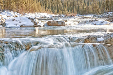 Elbow Falls in winter with golden light  Stock Photo