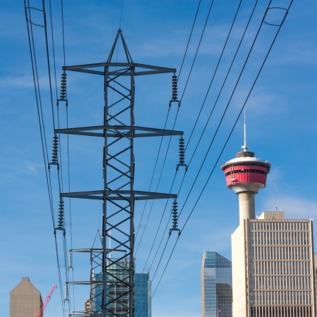 Cityscape of Calgary, Alberta, Canada with a high voltage power line