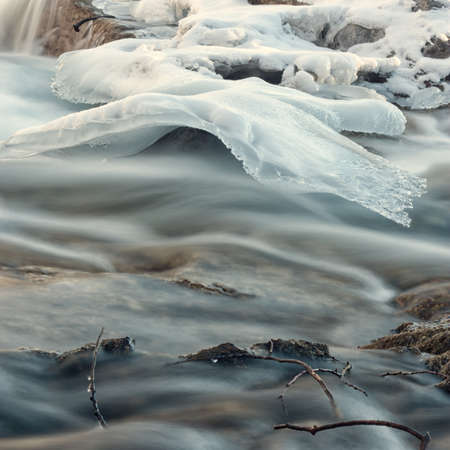 Close-up of an ice formation above a flowing creek
