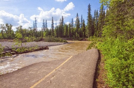 A destroyed pathway beside the Bow River from the Calgary 2013 flood.